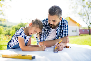 Father With Daughter Outside Planning